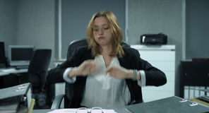 4K: A young employee is filing some documents in a modern office. She found some problems in the report and does not know how to handle it and throws one's