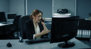4K: A young female manager is analyzing a report and found a big mistake inside. stock video