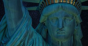 A 4K zooming close-up of the Statue of Liberty, Includes amazing footage of the milky way and shooting stars behind the statute stock video