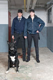 K9 squad police officers. Portrait of two young police officers of a k9 squad Royalty Free Stock Images