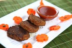 Ka Aluchap, cotoletta della carota, cotoletta di Gajar di mullangi di Manjal fotografie stock libere da diritti