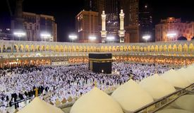 Kaaba in Mecca. Mecca, Saudi Arabia. Muslim pilgrims, from all around the World, are revolving around Kaaba at Night Stock Photography