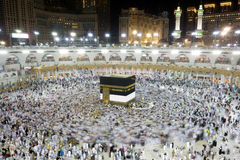 Kaaba in Mecca Saudi Arabia at Night. Muslim pilgrims, from all around the World, revolving around the Kaaba at night during Hajj in Saudi Arabia Royalty Free Stock Image