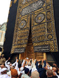 Kaaba, muslims and gold door Stock Image