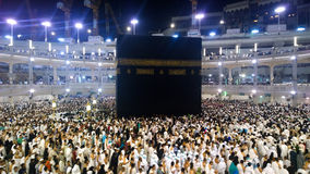 Kaaba. Picture of the Kaaba and a group of pilgrims they walk around to perform Hajj or Umrah, and all Muslims follow its, Located in Mecca in Saudi Arabia Stock Image