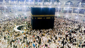 Kaaba. Picture of the Kaaba and a group of pilgrims they walk around to perform Hajj or Umrah, and all Muslims follow its, Located in Mecca in Saudi Arabia Stock Photo