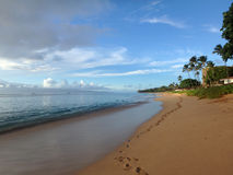 Kaanapali Beach at Dusk with trees and Lanai in the distance Royalty Free Stock Photos