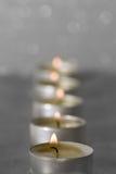 Kaarsen in een rij Stock Afbeeldingen