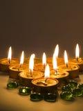 Kaarsen en kiezelstenen Stock Fotografie