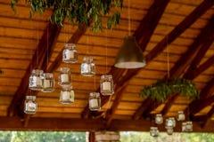 Kaarsen in kruiken Stock Afbeeldingen