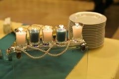 Kaarsen op de lijst Stock Fotografie