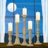 Kaarsen in Venster op Maanbeschenen Nacht Royalty-vrije Stock Afbeeldingen