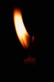 Kaarslicht op zwarte achtergrond Royalty-vrije Stock Afbeelding