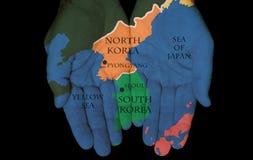 Noord- Korea - Zuid-Korea in Onze Handen Royalty-vrije Stock Afbeelding