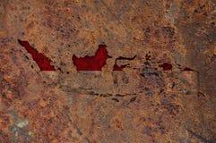 Kaart en vlag van Indonesië op roestig metaal royalty-vrije illustratie