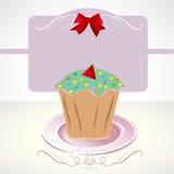 Kaart met cupcake en boog Stock Afbeeldingen