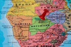 Kaart van Botswana een rode geplakte punaise Royalty-vrije Stock Foto