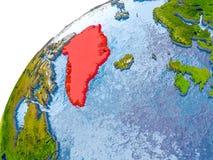 Kaart van Groenland in rood op bol Royalty-vrije Stock Foto's