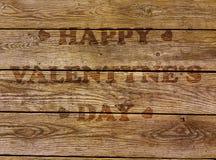 Kaart voor Valentijnskaartendag en hart op een donkere houten achtergrond Stock Afbeelding