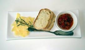 Kaas, brood en saus Stock Foto's