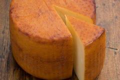 Kaas en een stuk Stock Afbeelding