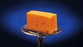 Kaas op de heldere vlekken Stock Foto's