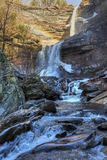 Kaaterskill Falls Rainbow. A rainbow shines at Kaaterskill Falls during a late February thaw in the Catskill Mountains of Greene Country, New York Stock Photos