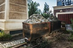 Rocks with funny gold in two lorries near the Baron attraction i stock image