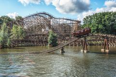 The water roller coaster The flying Dutchman with in the background the double track wooden racer roller coaster Joris and the dr stock image