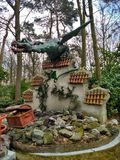 Kaatsheuvel / The Netherlands - March 29 2018: A dragon guarding treasure chests on the wall in Theme Park Efteling. Spring royalty free stock image