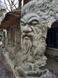 Kaatsheuvel / The Netherlands - March 29 2018: Giant head of a man with beard in Theme Park Efteling. Spring royalty free stock photography