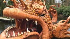 Kaatsheuvel / The Netherlands - March 29 2018: Theme Park Efteling. Big orange fish from the fairytale Pinocchio opens and closes its eyes and mouth, spits stock footage