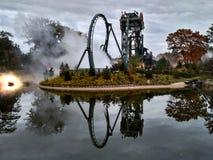 Kaatsheuvel / The Netherlands - November 03 2016: Speed roller coaster Baron 1898 in action in Theme Park Efteling. Symmetric stock photos