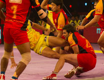 Kabaddi Raider Caught Stock Image