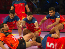 Kabaddi Raider and Defenders Royalty Free Stock Photography