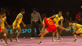 Kabaddi sport action. A scene from a Kabaddi game royalty free stock images