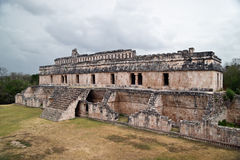 Kabah main palace. Puuc is the name of either a region in the Mexican state of Yucatán or a Maya architectural style prevalent in that region. The word puuc Stock Photography