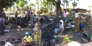 Kabalo, Democratic Republic of the Congo: Women selling charcoal royalty free stock photos