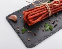 Kabanos delicious polish snack sausage on a stone plate white background stock photo
