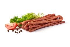 Kabanos. Polish long thin dry sausage made of pork. Isolated on white background.  stock photo