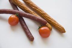 Kabanos with tomatoes on white background Royalty Free Stock Photography