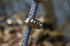 Kabel med bultar och muttrar royaltyfri fotografi