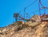 Kabelbilar över klippor Royaltyfria Foton