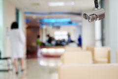 Kabeltelevisie-systeemveiligheid in werkende ruimte van de achtergrond van het het ziekenhuisonduidelijke beeld Royalty-vrije Stock Foto