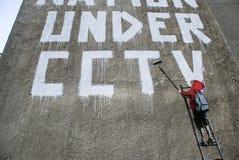 Kabeltelevisie van Banksy - het detail van de Jongen Stock Foto's
