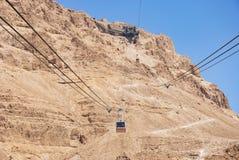 Kabelwagens en de Slangweg in Masada in Israël stock foto's