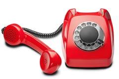 Kabla naziemnego czerwony telefon na odosobnionym białym tle Zdjęcia Stock