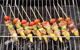 Kabob on BBQ grill. Bar-B-Q or BBQ with kebab cooking stock photography