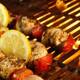 Kabob on  BBQ grill. Flaming  BBQ grill and meat kabobs Royalty Free Stock Images