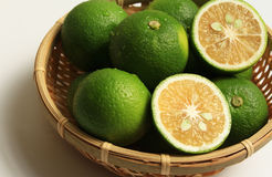 Kabosu on the colander. Citrus Cabos of Japan. Serve in bamboo basket Stock Photos